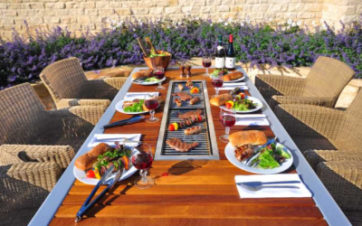 barbecue table bu ibbq with chairs and food