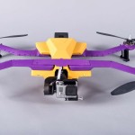 follow drones by airdog features a yellow and purple drone on a floor