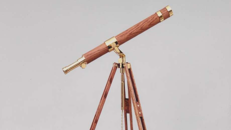 telescopes by glass eye shows a brass wood telescope with a grey background