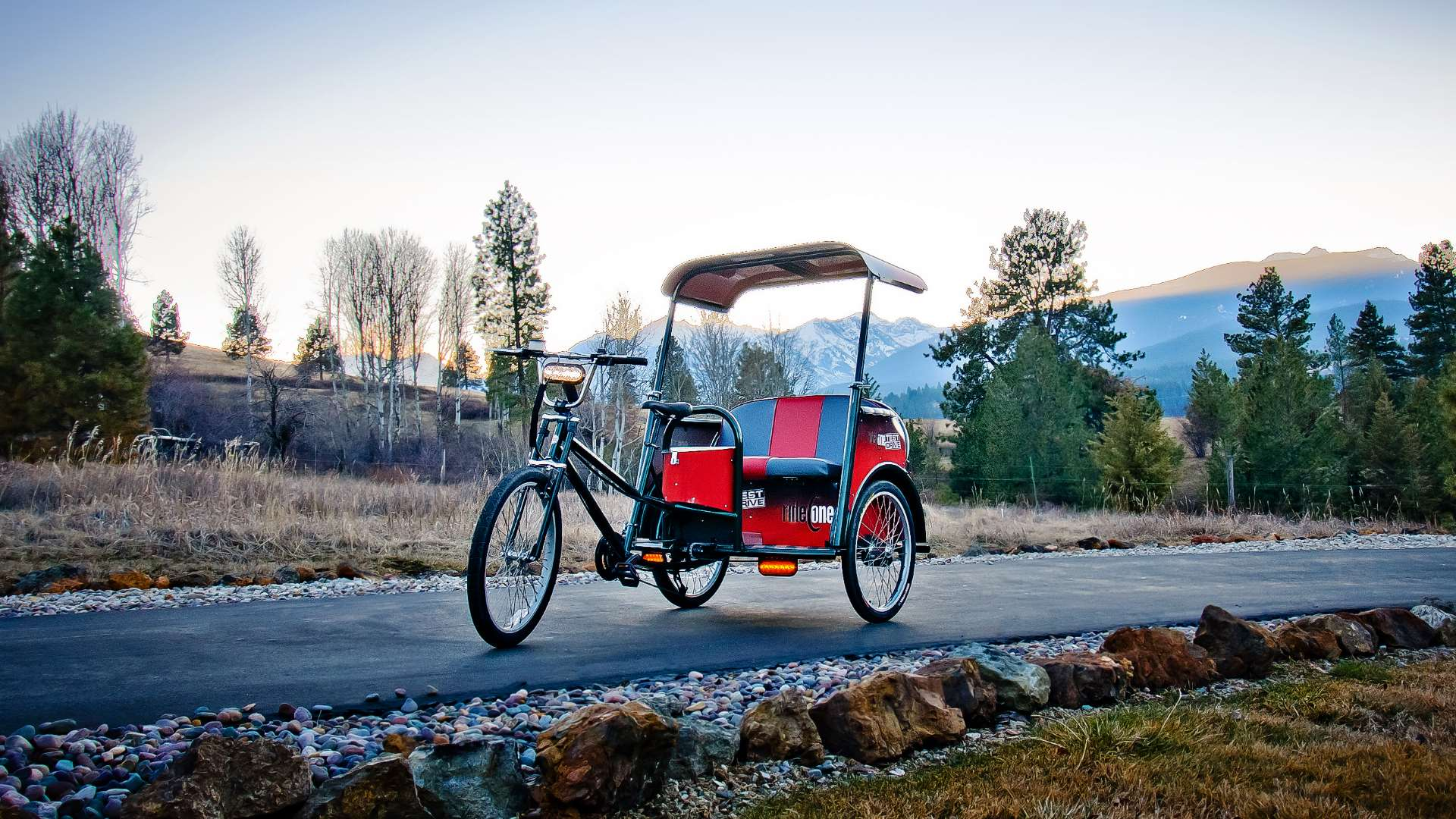 pedicabs by coaster a red and black pedicab on a road