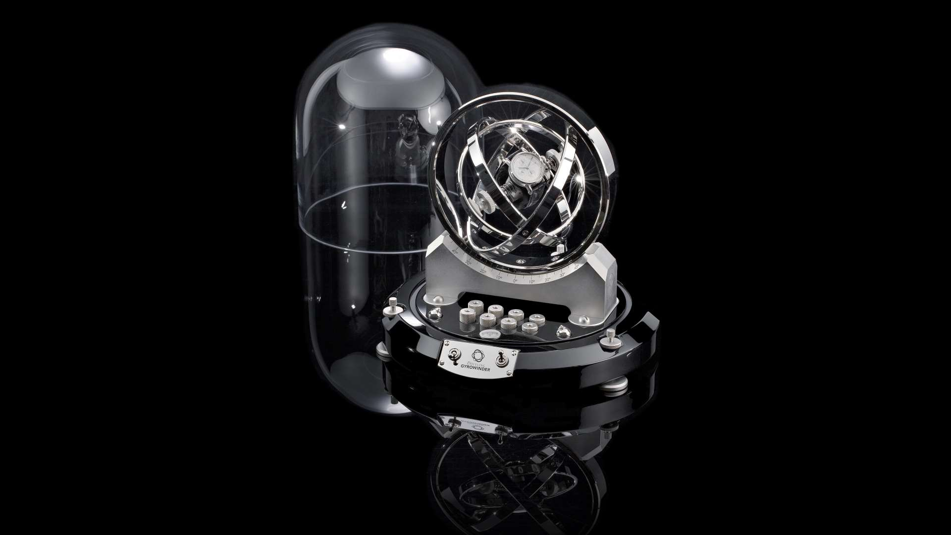 safes by dottling features a watch winder with a black background