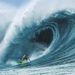 power surf boards by jetsurf shows a man on a power board engulfed in a huge wave