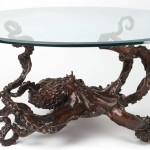 sculptures by Kirk McGuire a bronze glass octopus table with white background