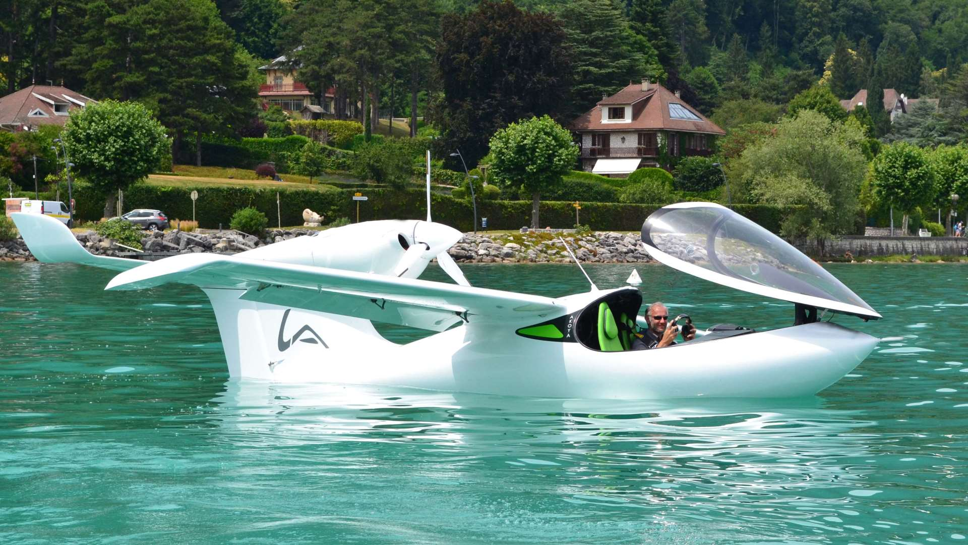 ski plane by Lisa Akoya an aircraft floating on a body of water