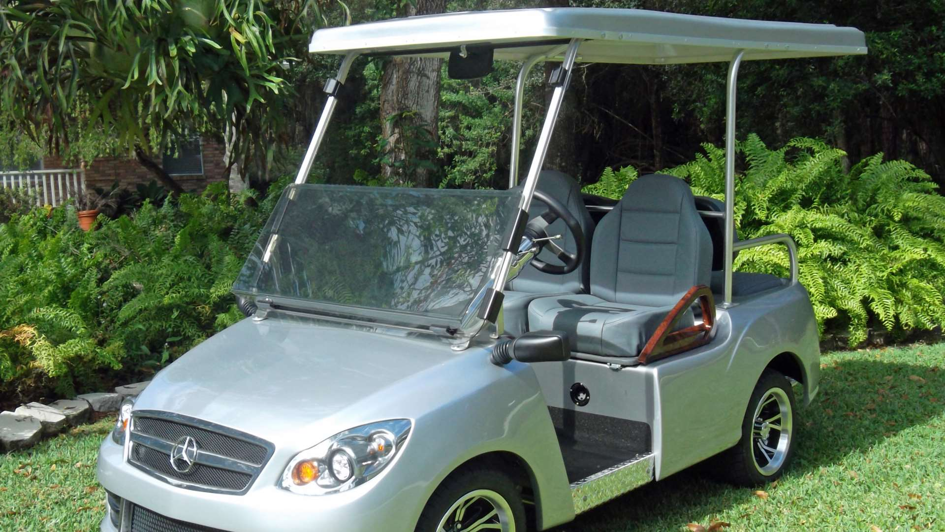golf carts by luxury golf carts features a silver cart on a manicured lawn