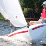 watercraft by Nauticraft sailing on the water with a sail