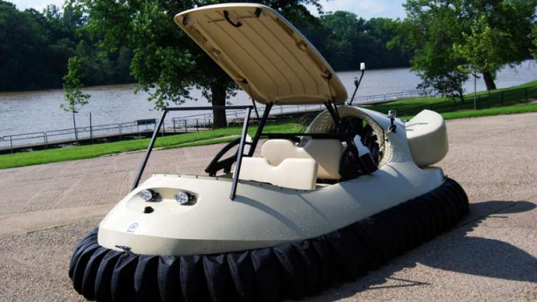 hovercrafts by Neoteric shows a hovercraft on a parking lot with a body of water in the background