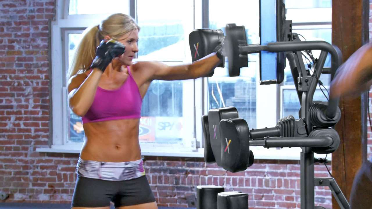 home fitness by nexersys shows a woman punching an exercise machine