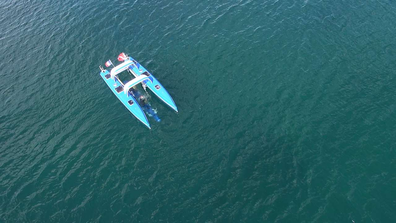 watercraft by Platypus craft shows a blue catamaran type in a large body of water
