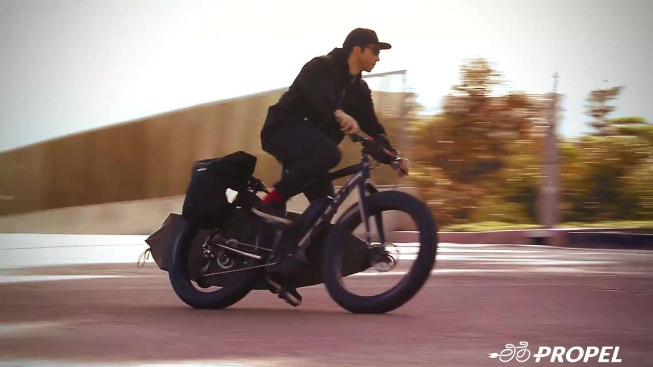 Propel Electric Bikes shows a man riding on a bike