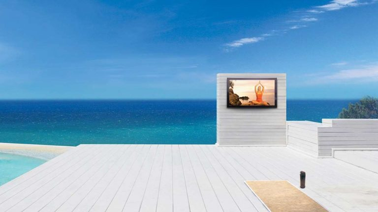 televisions by Séura Storm Weatherproof TV on a luxury patio with the ocean as a background