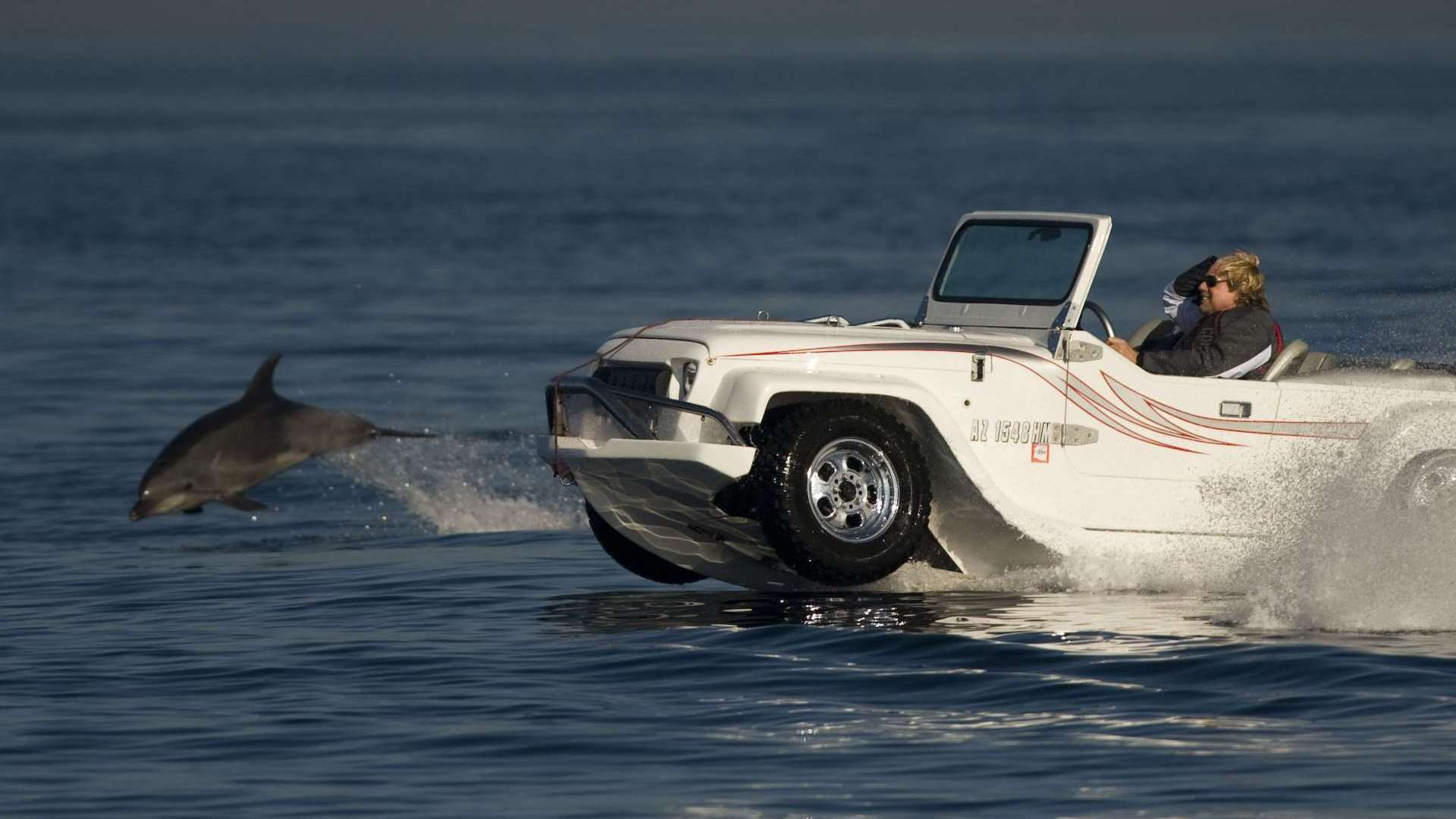 WaterCar amphibious vehicles a white jeep on the water with a dolphin