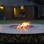 fire pits by AK47 Fire Pits on a lawn with a house in the background