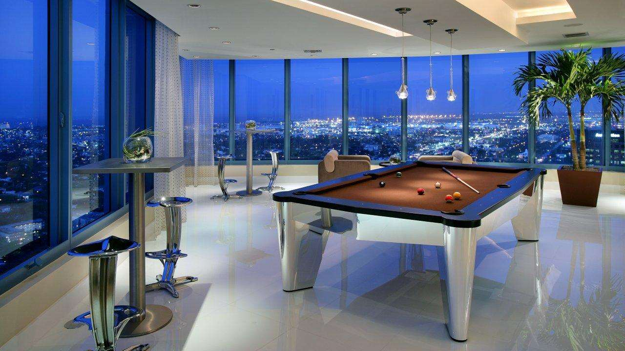 billiard tables by Mitchell billiard tavles featuring a chrome pool table in a penthouse