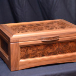 humidors by Vanderburgh humidors showcasing a humidor on a blue tableclothed table