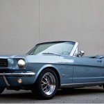 mustang by revology cars shows a blue mustang with the top down and a grey background