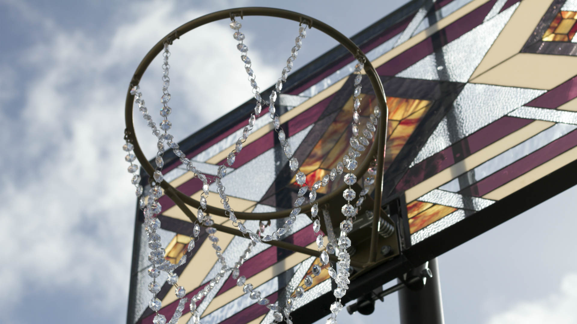 basketball by literally balling a stained glass back drop