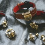 2 saints jewelry collection featuring rings and tie tacs
