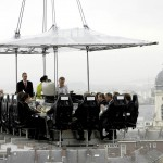 outdoor dining by dinner in the sky people hanging from a crane having dinner