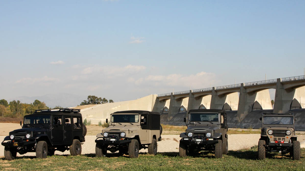 utility vehicles by icon utility vehicles vehicles in front of a river with a bridge in the background