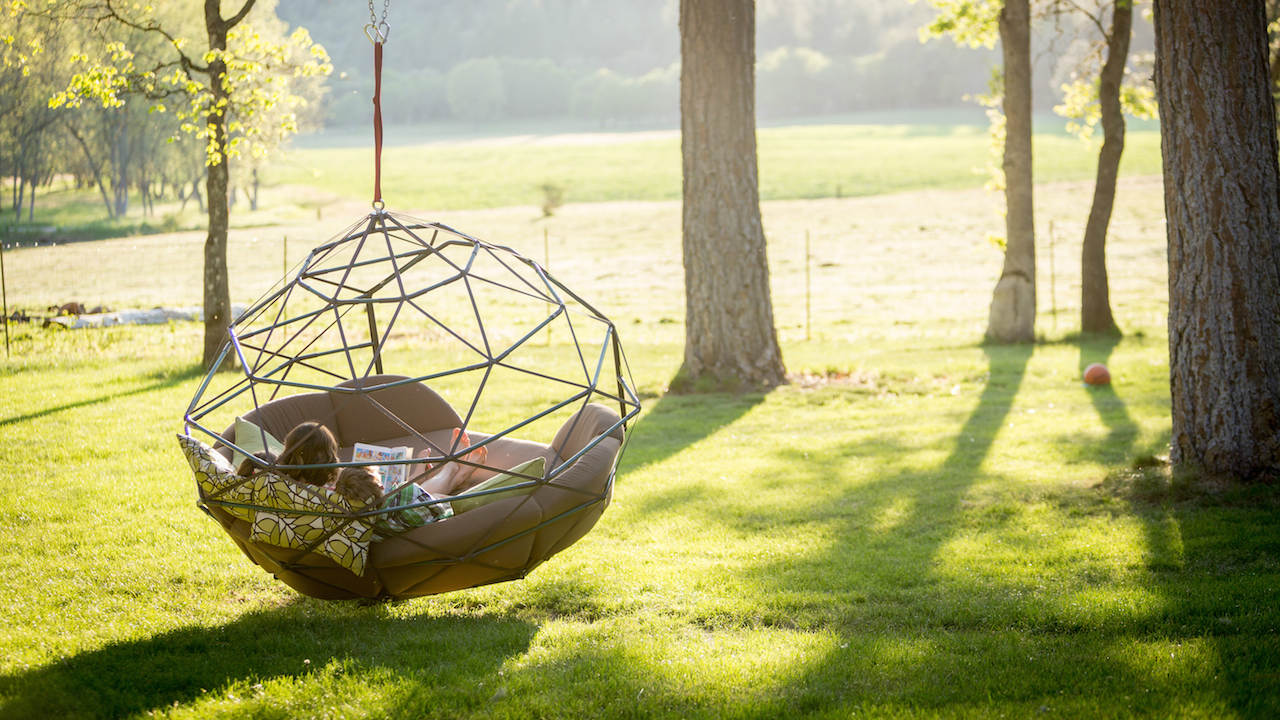 outdoor furniture by Kodama Zomes swing chair hanging from a tree