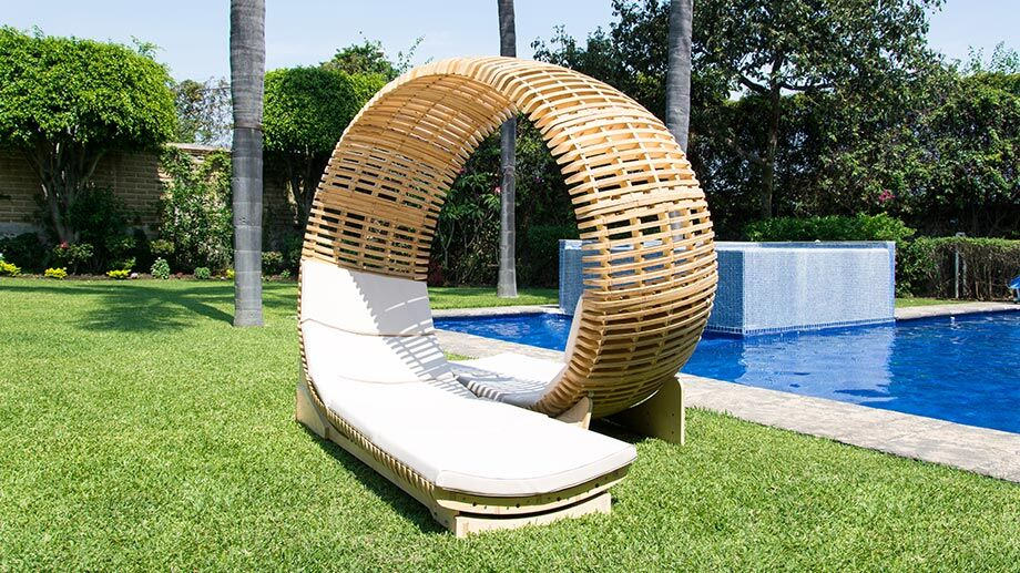 lounge chair by loopita in front of a pool