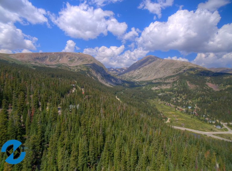 property in breckenridge colorado with beautiful mountains and cloudy blue skys