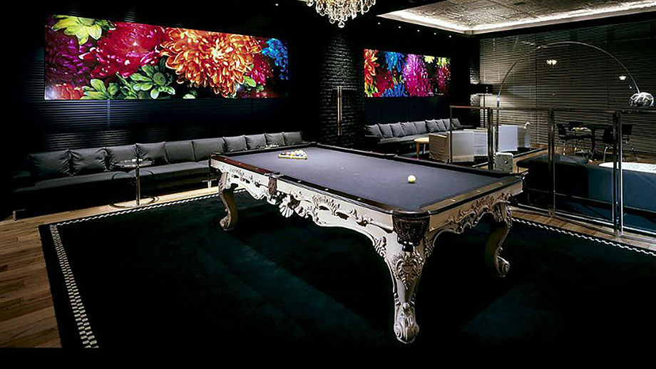 billiards by Olhausen a luxury pool table in a living room on black carpet