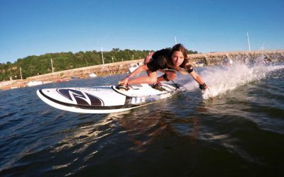 electric jet boards by Onean Electric JetBoard woman surfing in a body of water