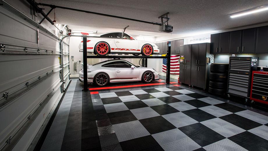 garage floors by Race Deck Garage Floors shows a black and white checkered floor with two white cars on lifts