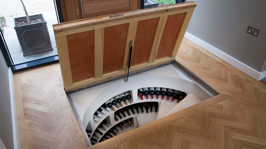 wine cellars by spiral wine cellars features a wine cellar in a floor with hatch door opened