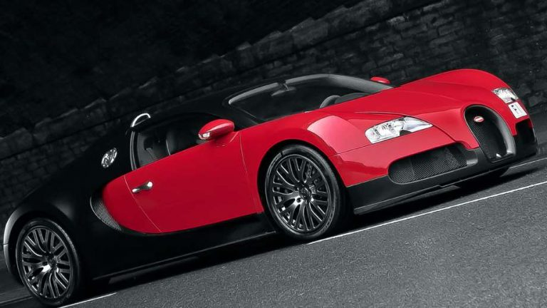 luxury vehicle by Kahn Design a red and black Bugatti