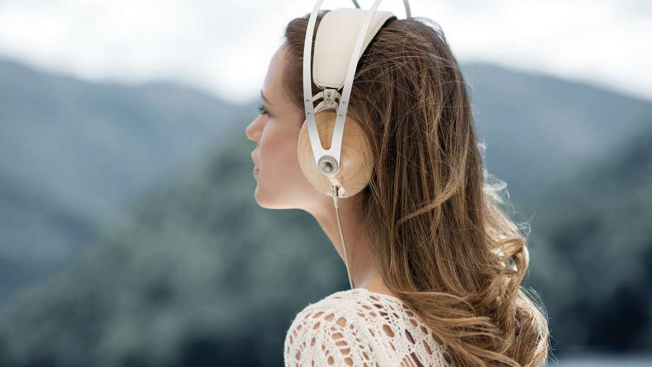 headphone by meze with a woman listening to music while admiring nature