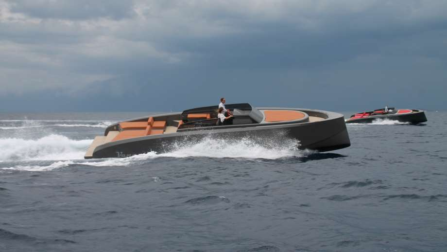 yachts by Vanquish Yachts in the ocean racing another boat | ToysForBigBoys.com