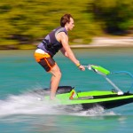 jet ski by Bomboard man on a body of water on a lime green jet ski
