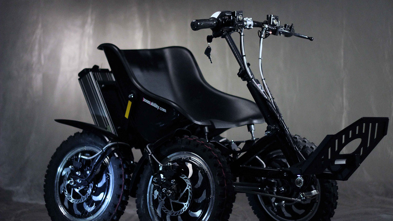 electric vehicle by Zoomability a sport wheelchair with a grey background