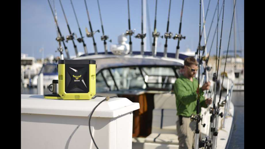 coffeemaker by OXX on a chest on a boat with fishing poles