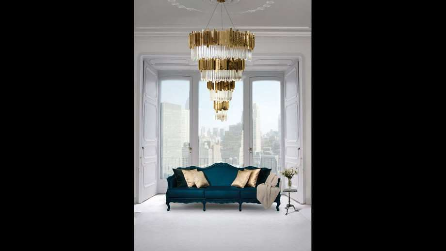 lamps by Luxxu a chandelier in a living room with a blue couch