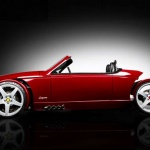 roadster by Vanderhall motor works a red roadster with black background
