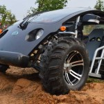 electric vehicles by Ecoruise driving over of mound of dirt