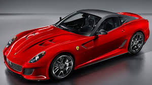 luxury cars a red ferrari with black top
