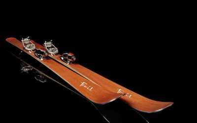 skis by Foilski a pair of luxury skis with a black background