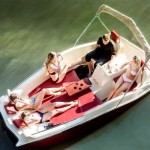 boat by JoyBoat Sky Yacht floating on a body of water with a family