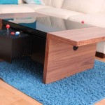 arcade tables by Surface Tension on a blue rug in a living room