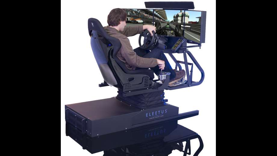 simulators by Eleetus Simulators a man playing with a driving simulator