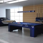 pool tables by Elysium in a garage with a bugatti and pool cues in the backround
