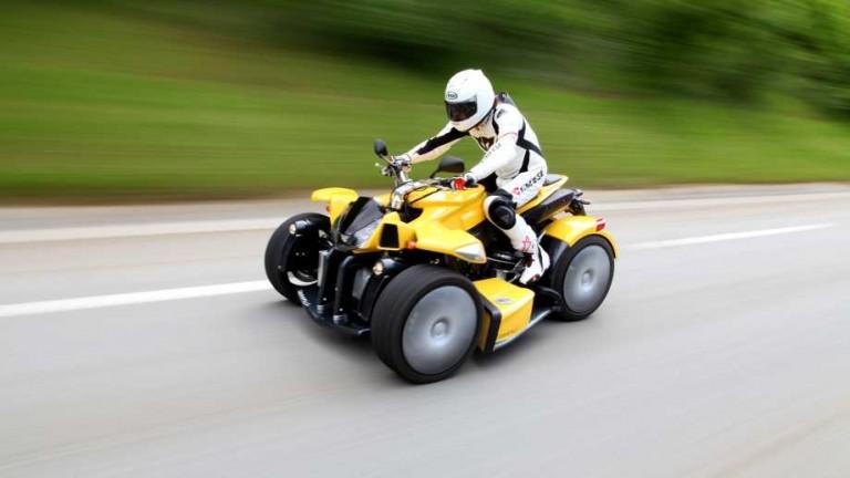 Lazareth ATV called the Wazuma a yellow atv driving down the road