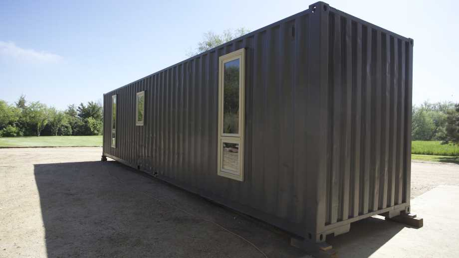 container homes by Walker Wilderness on a driveway with trees in the background