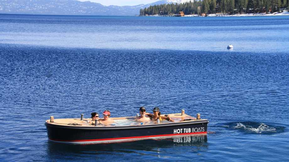 Hot Tub Boats boat floating in a body of water with passengers