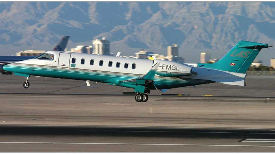 altus aircraft by Altus Aviation a turquoise and white plane taking off